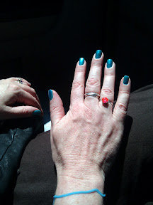 Beautiful spa nails, a silly bandz, and our Taxicab wedding ring.