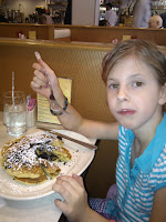 Emma has oreo pancakes for breakfast before departing wiht uncle Stephen.