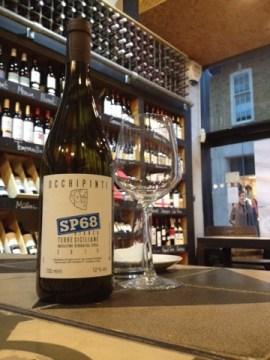 Bottle of Occhipinti SP68 wine in wine shop