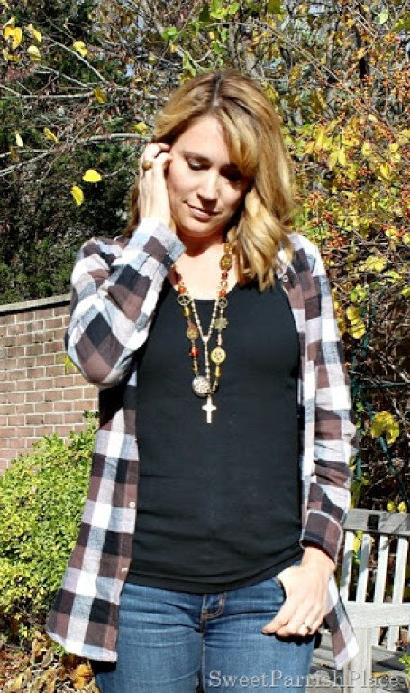 brown-plaid-shirt-flare-jeans-birkenstocks-4