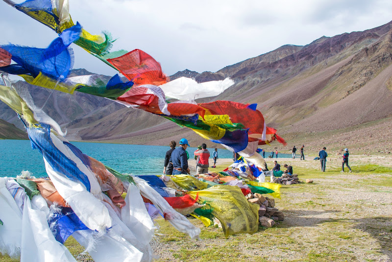 Prayer flags at Chandertaal lake, Hampta Pass Trekking