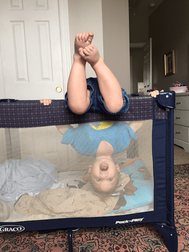 upside down in crib baby