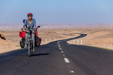 Tanya cycling in the desert