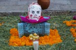 A candle and guava offerings on the streets of San Miguel de Allende, Mexico on the Day of the Dead (Dia de los Muertos).