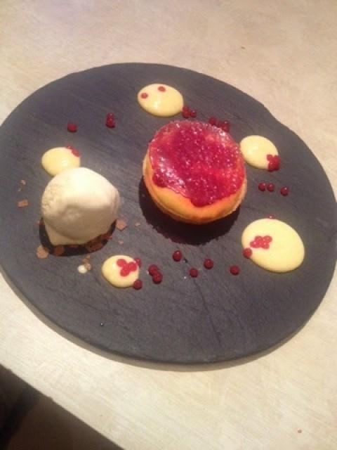 Rhubarb tart with vanilla ice cream and raspberry caviar