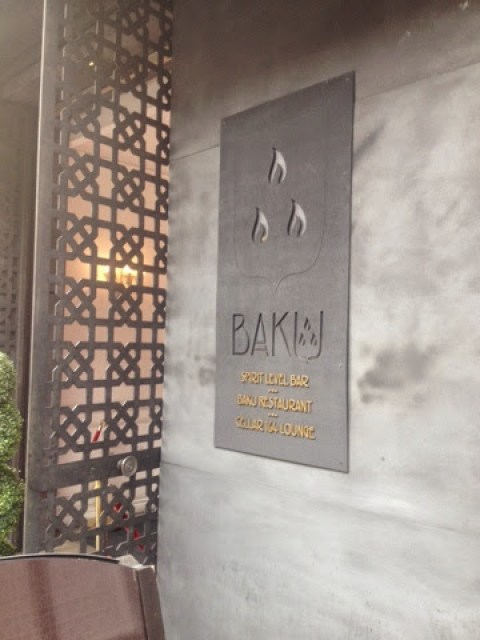 The sign for Banku London, with the flame-topped logo