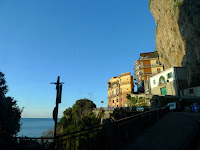 Brilliant blue sky and the moon over Amalfi as we depart in the early morning.