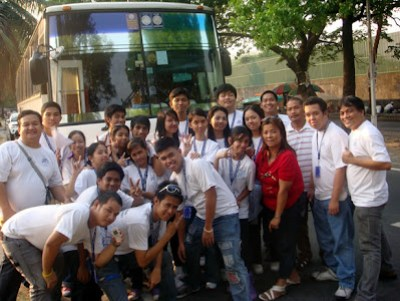 March 25: Students pose in front of Histoury Tours Company Bus together with company officials.