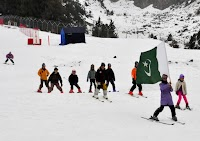 People skiing at Naltar Ski Resort
