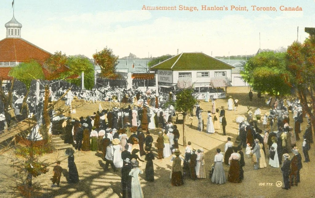 postcard-toronto-island-hanlans-point-spelled-hanlons-amusement-stage-big-crowd-note-candy-and-pop-corn-factory-building-centre-c1910