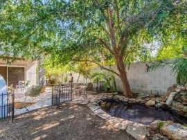 Backyard pond and waterfall in homes for sale in Gilbert AZ
