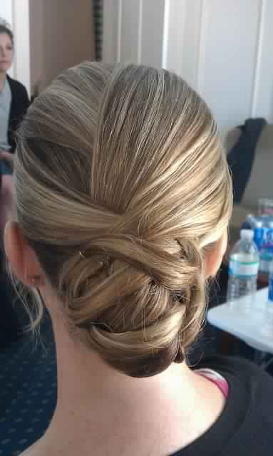 Sleek Braided and Pinned Up Updo Hairstyle