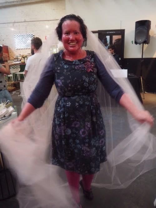 Carly Findlay trying on a wedding veil