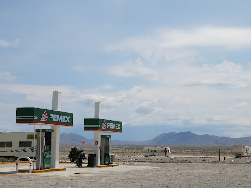 Stopped at the PEMEX station after the military checkpoint to grab a cold coke and Paul put in a spare bolt.