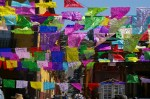 Looking up the Correo street through paper cut-outs adorning the Day of the Dead (Dia de los Muertos) in San Miguel de Allende, Mexico.