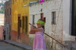 Carla, our Mexican-American neighbor getting ready for her turn to take a swing at a Piniata on a cobblestone street of Colonia San Rafael in San Miguel de Allende, Mexico.