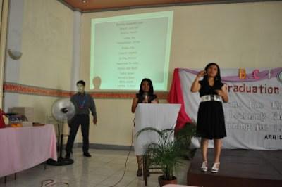 School Coordinator Loida Alvarez calls on each graduate.