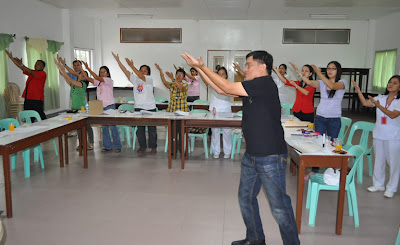 "Sir Jojo teaches ""Our Father"" to participants."