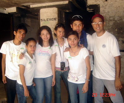Students with Sir Oscar (right) took a photo inside ruins of old soldiers' barracks.