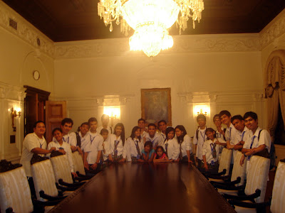 March 12: Students circle around the former Presidential Staff Table in Malacanang Palace.