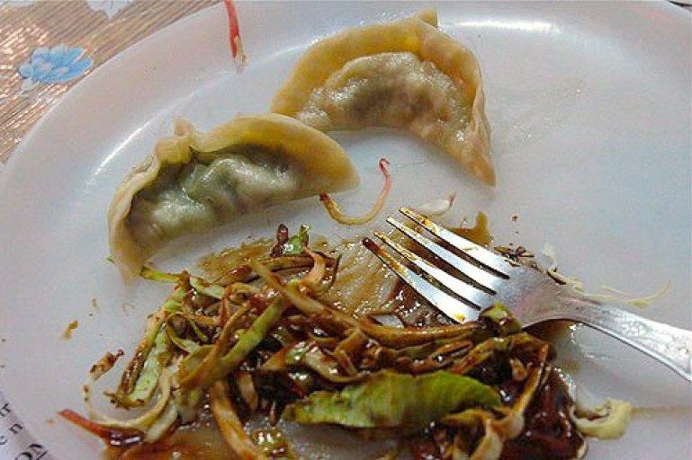 eating momos, tibetan momo dumplings