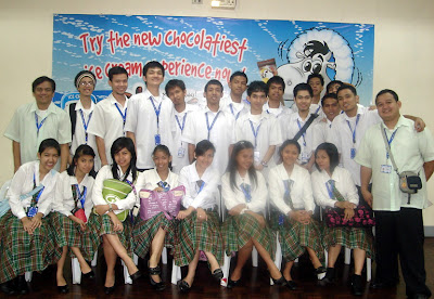 February 24: Students pose behind the Nestle tarpaulin.