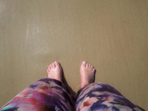 My feet on the sand at the beach