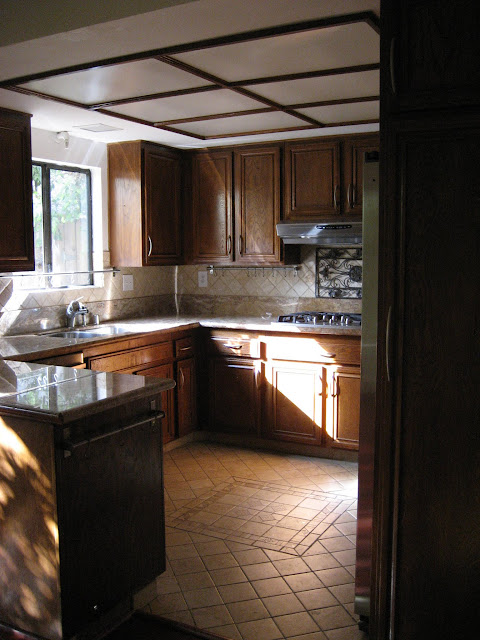 Sunny kitchen with a window over the dual sink.