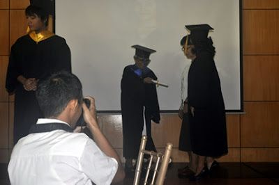 A student receives her diploma.