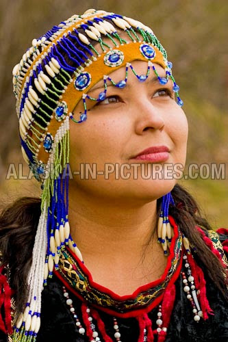 Alaskan Native and Hmong: Incorporate beads into their head wear