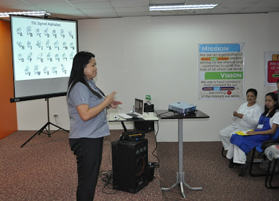 Batch 2: One of the HR staff introduces herself in sign language.