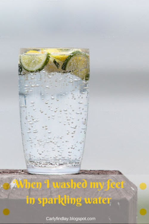 Image: glass of sparkling water with lemon and lime. Text: 'When I washed my feet in sparkling water.