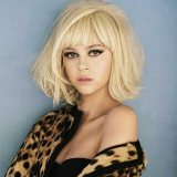 layered haircuts with side swept bangs 2015