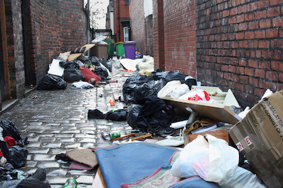 Garbage-strewn alley used to explain editing by yourself