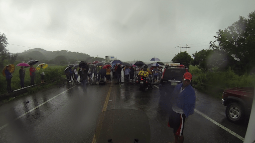 Six kilometres before San Pedro de Tepanatepec we encountered this roadblock. It was raining hard and we had done a few tough water crossings. We spoke with a truck driver about the holdup and he said we should speak with the protesters because they might let motorcyclists through.