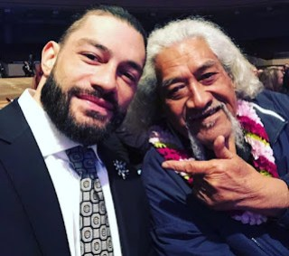 Roman Reigns and his father Sika Anoa'i in an event