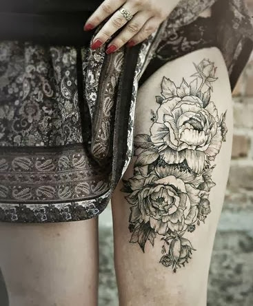 female thig tattoos