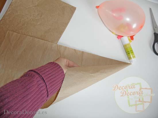 Decorar una fiesta con cucuruchos de globos.