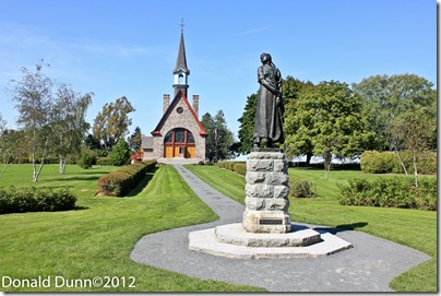 Grand-Pré National Historic Site of Canada, the basis of Longfellow's Evangeline, shown as a statue here, in Nova Scotia