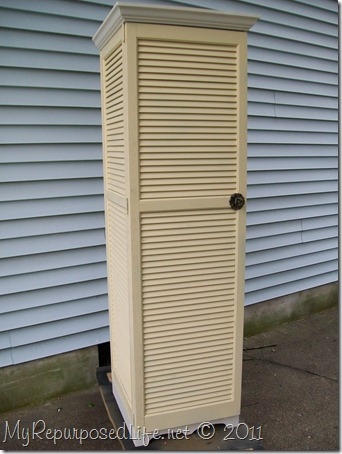 tall yellow shutter cupboard