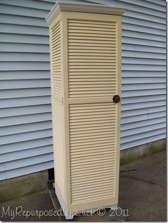 tall yellow shutter cupboard