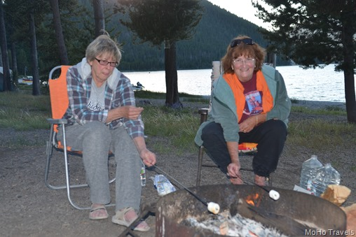 Nancy and Sue making s'mores with less (no crackers)