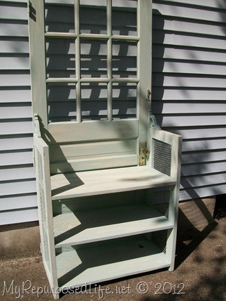 door repurposed into nightstand-bookshelf