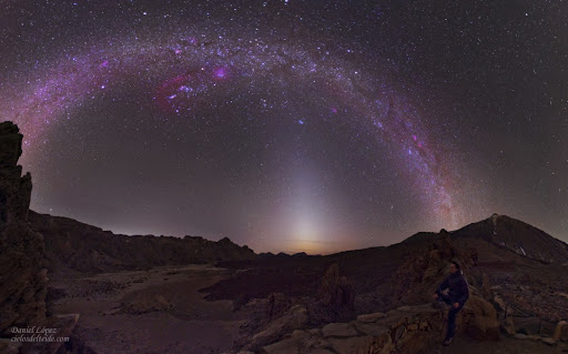 In the picture, the narrow triangle of Zodiacal light extends above the western horizon and seems to end at the lovely Pleiades star cluster. Arcing above the Pleiades are stars and nebulae along the plane of our Milky Way Galaxy. Recorded on March 10 from Teide National Park on the island of Tenerife, the vista is composed of 4 separate pictures spanning over 180 degrees.