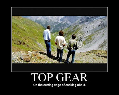 the three Top Gear presenters seen from the rear, looking over a precipice, captioned with one of the show's post popular sound-bites: TOP GEAR - at the cutting edge of cocking about