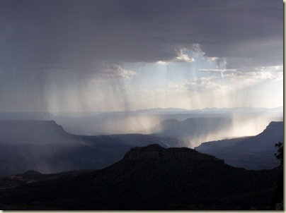 Sun through rain clouds over canyon from Crazy Jug Point Kaibab National Forest Arizona