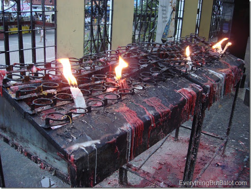 Burning candle offerings at Antipolo Cathedral