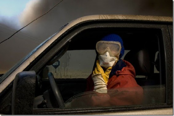 Wearing a mask and goggles to protect against the smoke, dairy farmer Berglind Hilmarsdottir from Nupur, Iceland, looks for cattle lost in ash clouds, Saturday, April 17, 2010. (AP Photo/Brynjar Gauti) #