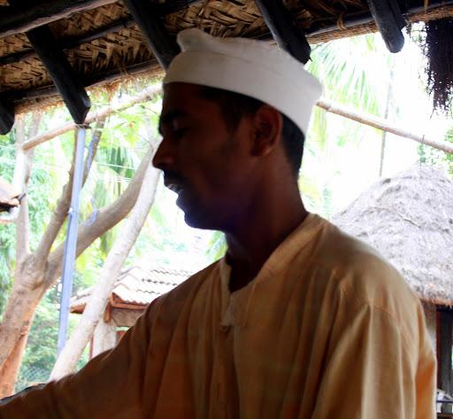 Men in Dhoti-Kurta serving Food