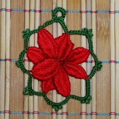 Flor cluny de pétalos rojos y borde verde